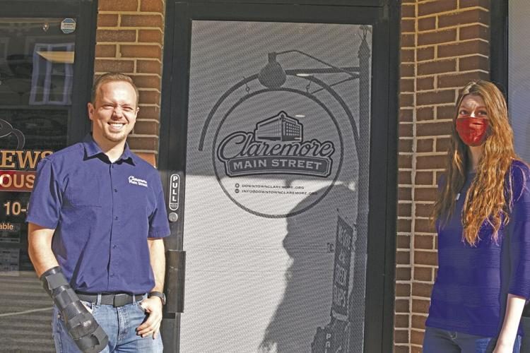 Executive Director Jacob Garrison and Executive Assistant Shiloh Johnson stand outside the new offices of Claremore Main Street.  Chelsea Weeks / Progress photo